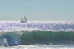 Sailboat waves in forground